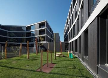 Housing and Business Location Am Garnmarkt - courtyard with kindergarten