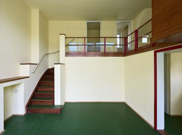 Werkbundsiedlung Restoration - House Loos - two-story living-dining room